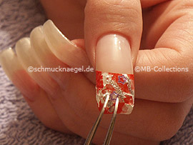 tweezers and three nail art star shapes