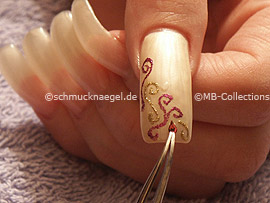 clear nail lacquer, the tweezers and two drop shaped strass stones