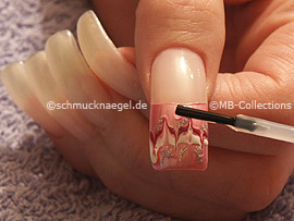 clear nail lacquer, the tweezers and a quadratic strass stone
