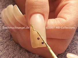 spot-swirl, strass stones and nail art liner in the colour gold-glitter