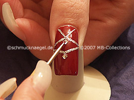 clear nail lacquer, spot-swirl and quadratic strass stones
