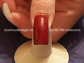 nail lacquer in the colour dark-red
